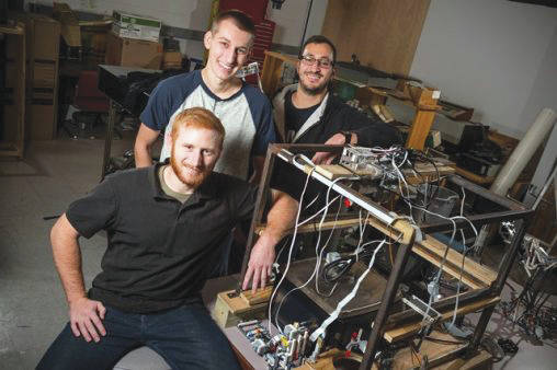 Submitted photo From right: Mahmoud Kamel, Austin Knoblauch and Mark D. Swartz were among the Wright State mechanical engineering students who designed a system for testing retail scales for Hobart.
