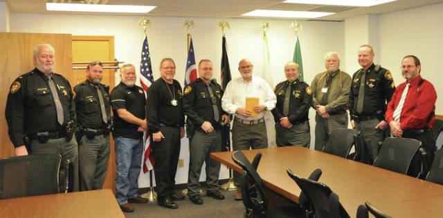 Submitted photo Greene County Sheriff's Office employees presented $2,811 to Chris Stanley, executive director of Fisher-Nightingale Houses, Dec. 21 at the end of their No Shave November & December fundraiser.