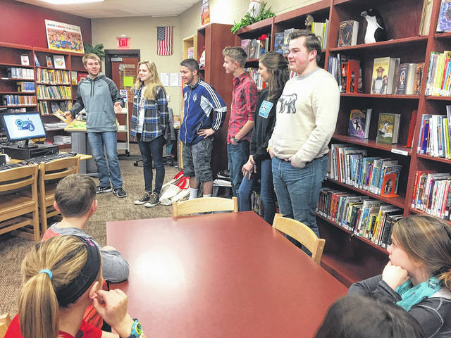 Submitted photo In recognition of Martin Luther King Jr. Day Cedarville High School speech class students presented a book about King Jr., to a third grade class in the elementary library. Pictured (left to right) are Wes Wickline, Kait Belliveau, CJ Pahl, Jared Waltz, Anna Winter, and Ryan Alex.