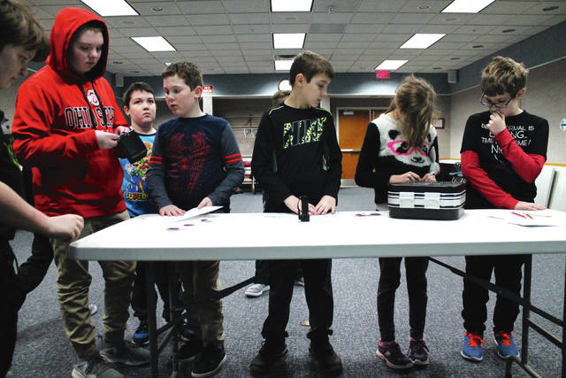 """Anna Bolton   Xenia Gazette Local kids used puzzles to """"break out"""" of a Xenia Library room during an escape room program Jan. 17. Working together under a ticking clock, the group of kids, aged 10-18, solved various riddles in the Minecraft world to figure out combinations, open locks, and break into two game boxes. Greene County Public Library offers other programs throughout the month, which can be found on its website."""