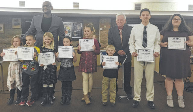 Submitted photo The Xenia Community Schools Board of Education recognized its January Kids of Character during the Jan. 15 meeting. Pictured with Superintendent Dr. Gabe Lofton (left) and Board Vice President Dr. Paul Dillaplain are Mackenzie Duncan (Shawnee), Avery Jackowski (Cox), Laryssa Bradley (McKinley), Devon Bottorf (Arrowood), Ava Wellman (Tecumseh), Zain Livers (preschool), Colin Pham (Warner), and Breonna Anderson (high school).