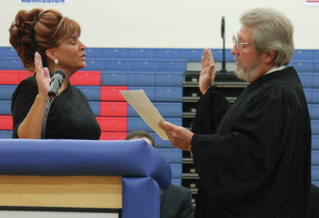 File photo Federal Court Judge Thomas Rose swore in Clerk of Courts Terri Mazur to her sixth term December 2016 at Greeneview High School.