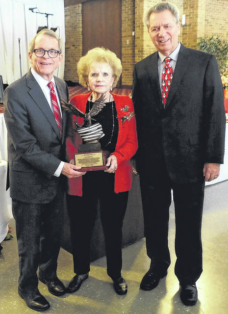 Attorney General Mike DeWine (left) recently received the American Nationalities Movement Freedom Award from past president Irene Morrow and current president Ralph Perk Jr.
