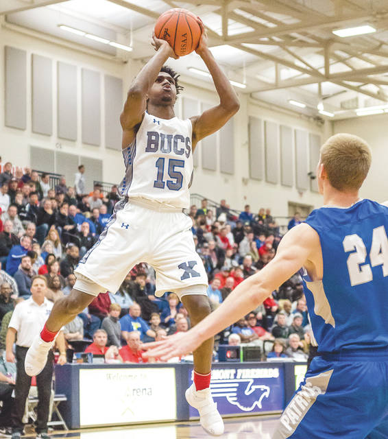 Xenia junior Samari Curtis (15) puts up a shot over a Liberty defender during Saturday's Flyin' to the Hoop basketball showcase game, Jan. 13 at James S. Trent Arena in Kettering. Curtis led the Buccaneers with 25 points scored in a 67-60 win.