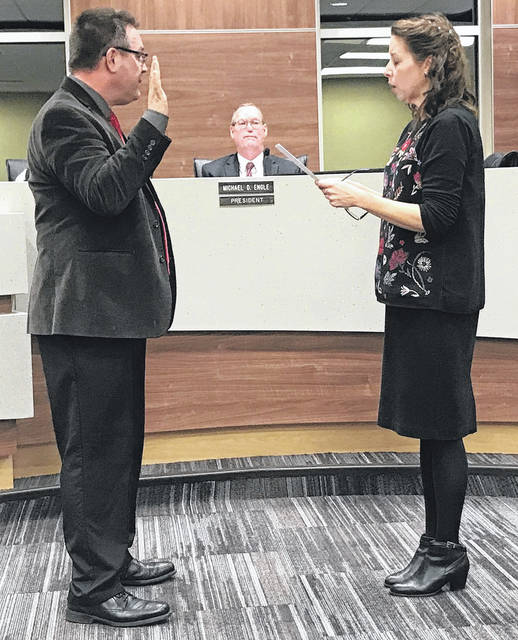 Wes Smith is sworn in for another term by Donnette Fisher.