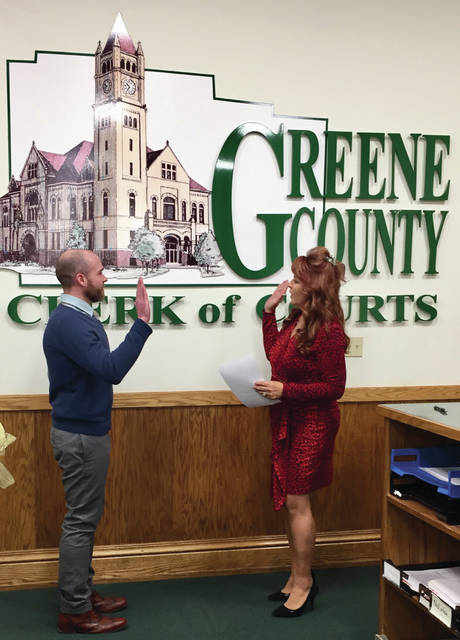 Submitted photos Greene County Clerk of Courts Terri Mazur swears in A.J. Williams. Williams was appointed by the Board of Commissioners to take over Mazur's position on an interim basis and has since taken office.