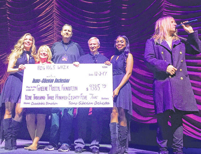 Submitted photo Greene Medical Foundation was the recipient of $9,385 from a benefit concert performed by the Trans-Siberian Orchestra at the Nutter Center. TSO representatives presented the check to GMF Board Members Treasurer Eric Murray and John Finlay during the concert Dec. 2.
