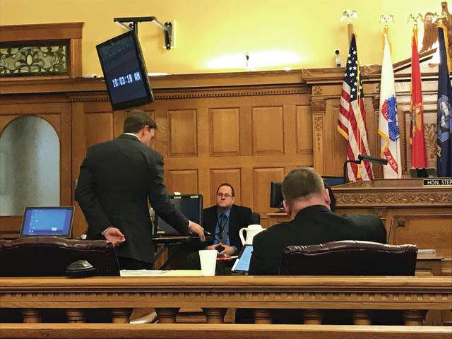 Anna Bolton   Xenia Gazette Assistant Prosecutor David Morrison questions Detective Gilbert on the stand during trial Jan. 24 as Detective Shawn Bradley listens.