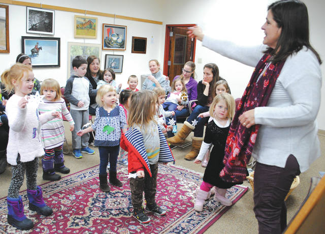 """Participants were given paper snowflakes, then were invited to sing and """"dance like a snowflake"""" to a song about the season."""