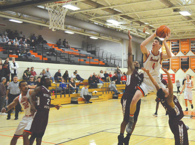 Beavercreek's Brayden Walther (4) flies to the basket in the first half of Tuesday's Feb. 6 boys high school basketball game against Cincinnati Western Hills. Beavercreek won the nonleague contest, 59-38.