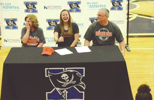 Xenia High School senior Marissa Babb (center) shares a laugh with her parents, Tara and Don Babb, prior to Marissa's signing of her National Letter of Intent, Feb. 15, to attend Heidelberg University and play women's soccer for the Student Princes.