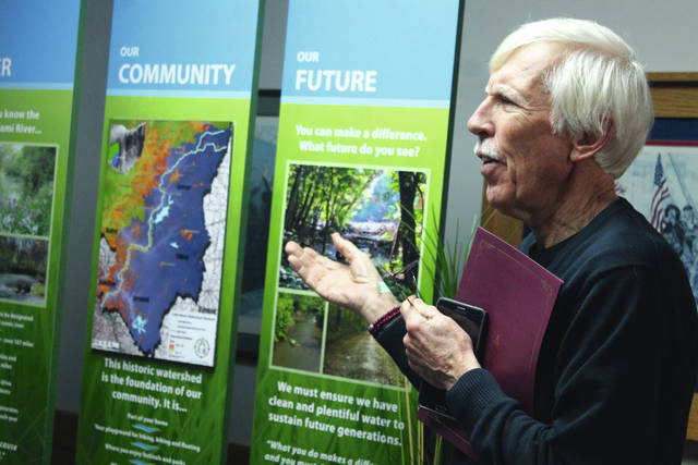 Anna Bolton   Greene County News Bill Schieman from Little Miami Watershed Network presents a new display in celebration of the 50th anniversary of the signing of the Ohio Scenic Rivers Act.