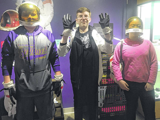 Submitted photos Eighth Grade members of Bellbrook Middle School's Kids 'n Science Club recently visited the Boonshoft Museum of Discovery. Pictured, students try on astronaut gear.