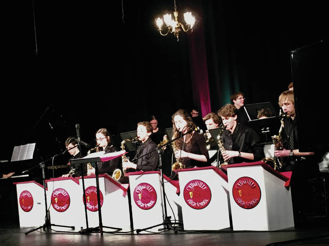 """Submitted photos Cedarville University Jazz Band, directed by Chet Jenkins, and Cedarville High School Jazz Band, directed by Jason Mahan, performed Feb. 10 at the Cedarville Opera House. CHS performed jazz and rock standards like """"It Don't Mean a Thing If it Ain't Got that Swing"""" with vocalist Maddie Bigham. The university's band followed with love tunes including Count Basie Orchestra's arrangement of the Ray Charles classic, """"I Can't Stop Loving You."""" The two bands ended the concert with a combined performance."""