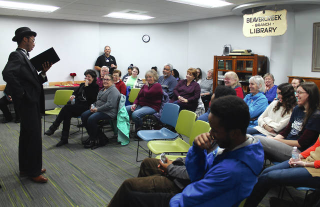 Anna Bolton | Greene County News Nathan Price impersonated Paul Laurence Dunbar in full period costume Feb. 15 at the Beavercreek Library where he read Dunbar's poetry to a full room.