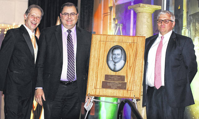 Barb Slone | Greene County News F.M. Torrence Award winner Perk Reichley (center) with chamber President/CEO AlanLiming (left) and chair of the board Ron Lewis.