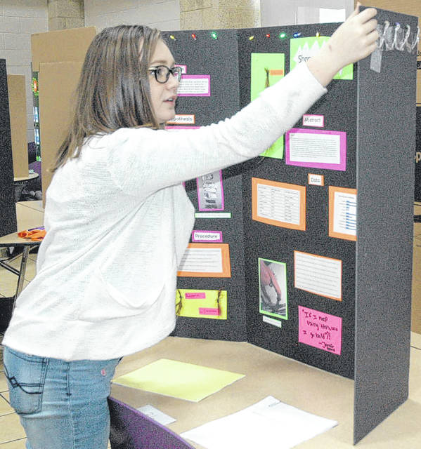 Juliana Packard puts some finishing touches on her project about shampoo. She received an excellent rating with 30 points.