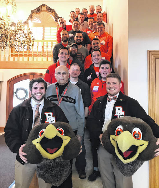 Xenia's Spencer Lockwood (right), one of two Freddie Falcons at Bowling Green State University, is shown with the other Freddie, Brian Chaney, and former Freddies.