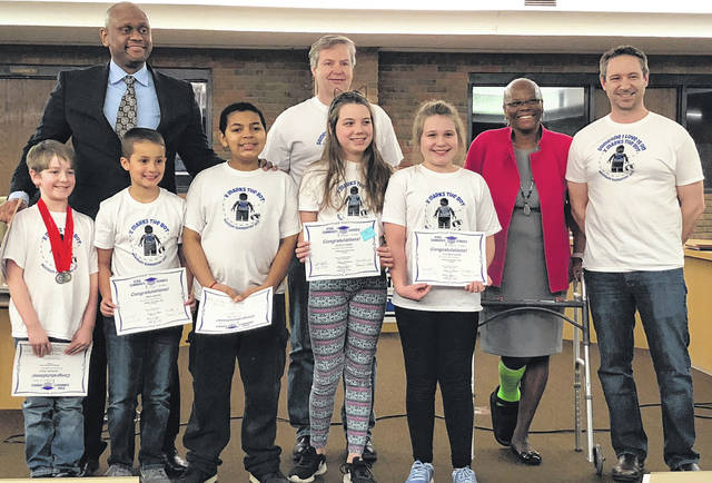 Scott Halasz | Greene County News McKinley Elementary Scholl's Lego robotics team, X Marks the Bot, was recently recognized by the Xenia school board for its performance at a recent competition. Pictured with Superintendent Dr. Gabe Lofton and Board President Cheryl Marcus are Zachary Tolle, Trey Greene, Malaki Gill, Jocelyn Bohn, Taylor Walker and Coach Tim Carey. Also recognized but not pictured are team members Abigail Hutchins, Taylor Fuchs, Alisha Lindsay, and Christoper Chandler, and Coach Steven Tolle.
