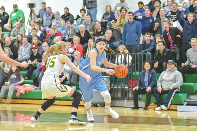 With a large contingent of Legacy Christian Academy fans cheering her on from the stands behind her, the Knights Emily Riddle drives past a Troy Christian defender for a score, Feb. 8 in a Metro Buckeye Conference girls high school basketball game in Troy.