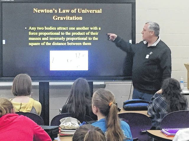 Submitted photos Bellbrook resident Tim Slauenwhite, who has worked for the Air Force for 28 years, explains the Law of Universal Gravitation and orbital motion to students at Bellbrook Middle School.