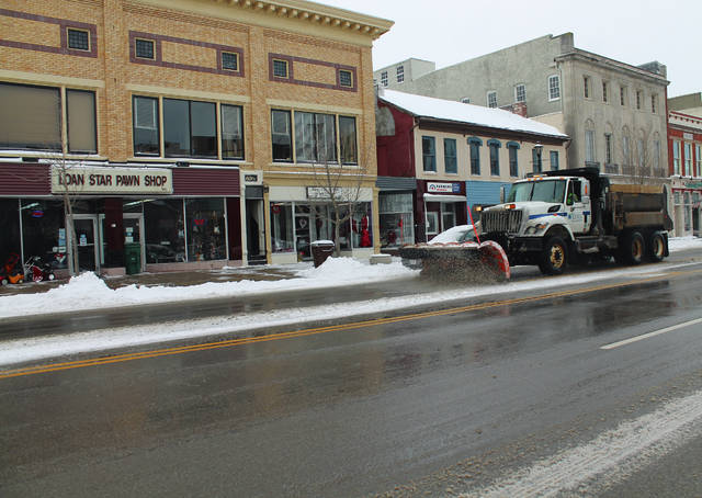 Anna Bolton | Greene County News Plow trucks and crew keep downtown Xenia roads clear Feb. 7 after a snowfall. The snow kept most residents off the sidewalks — except for one couple — but allowed for fairly regular through-traffic by mid-morning.
