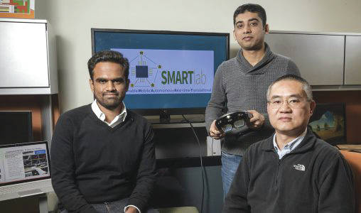 "Submitted photo From left: Wright State researchers Miteshkumar Vasoya, Ashutosh Shivakumar and Yong Pei designed an augmented-reality system designed that puts a ""doctor in the house"" to help recovering surgery patients manage pain without painkillers."