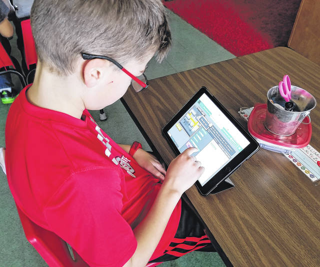 Submitted photos A student in Dalton Pate's class at Greeneview Elementary School works on a project in coding class.