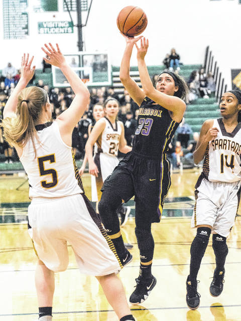 Bellbrook sophomore guard Brooklyn Hall (33) puts up a shot in the first half of Friday's March 2 Division II girls high school basketball district title game against Cincinnati Roger Bacon in Mason. Hall led all scorers with 20 points in the Golden Eagles win.