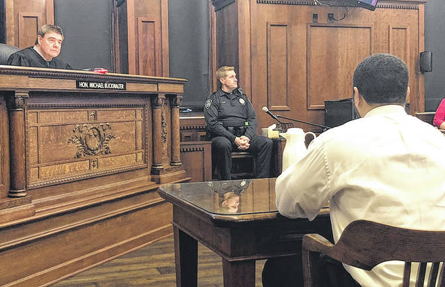 Scott Halasz | Greene County News Xenia police officer David Elliott testifies as Judge Michael Buckwalter looks on.