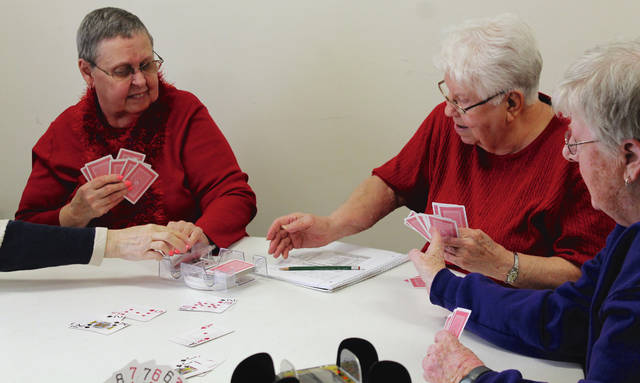 Anna Bolton | Greene County News Betty Brooks, Mary Hunte and Jeannette Morgan play Shanghai Rummy with a group of women at the Xenia Adult Recreation & Services Center, 130 East Church Street on March 12.