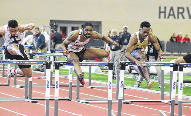 Submitted photo Central State University hurdler Juan Scott (center) captured the 60-meter hurdles national title at the NCAA Division II Indoor Championships, March 10 in Pittsburg, Kansas.