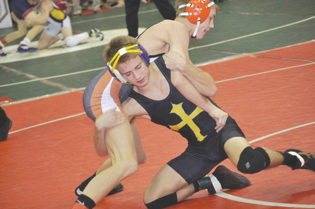 Legacy Christian's Tommy Hoskins puts Newcomerstown's Logan Hursey into a hold, during the 126-pound weight class consolation semifinals match March 10 in Columbus.