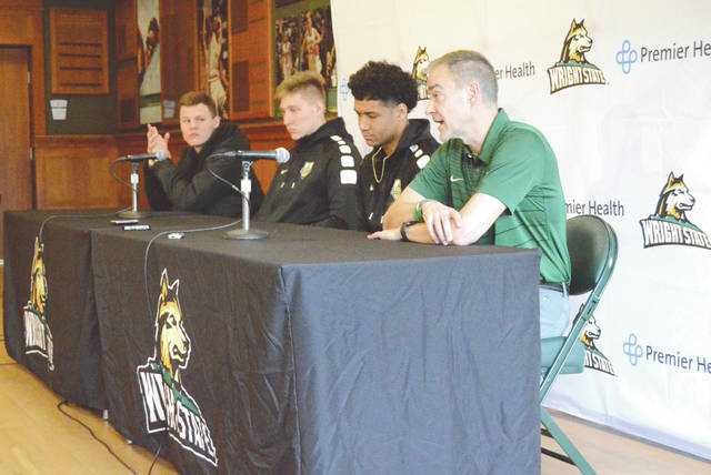 Wright State University men's basketball players (left to right) Grant Benzinger, Loudon Love, Mark Hughes and their coach, Scott Nagy, speak with media members March 8 in the Setzer Pavillion on the Wright State University campus in Fairborn.