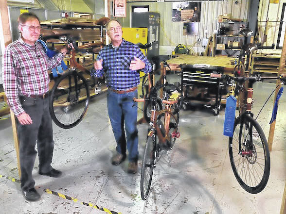 """Submitted photo Jay Kinsinger and Scott Phillips talk about the E-Bike during the taping of the """"The American Woodshop"""" program from Cedarville University."""