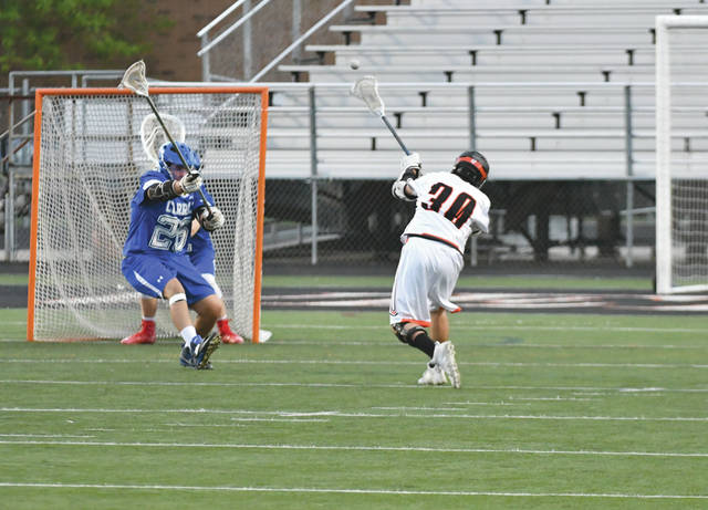 Quick reactions and plenty of hard hits are all a part of the bruising fast-paced game of high school lacrosse.