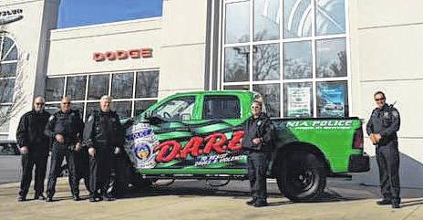 Submitted photo Xenia police personnel show off the department's new DARE vehicle.