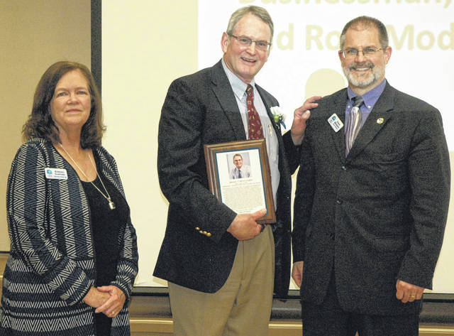 Scott Halasz   Greene County News Local businessman Brad Montgomery receives his plaque with Xenia Community Schools Foundation Executive Director Barbara Stafford (left) and President Steve Brodsky (right).