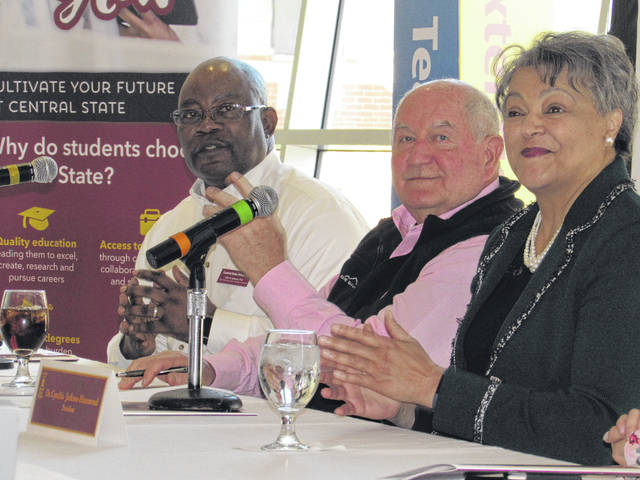 Central State University Dean Alton B. Johnson, at left, U.S. Agriculture Secretary Sonny Purdue, center, and Central State President Dr. Cynthia Jackson-Hammond talk with agriculture students during a panel discussion on agriculture Thursday at the university.
