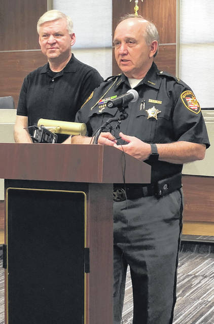 Scott Halasz | Greene County News Greene County Sheriff Gene Fischer speaks about the incident in Xenia April 26 as Xenia Police Chief Randy Person observes.