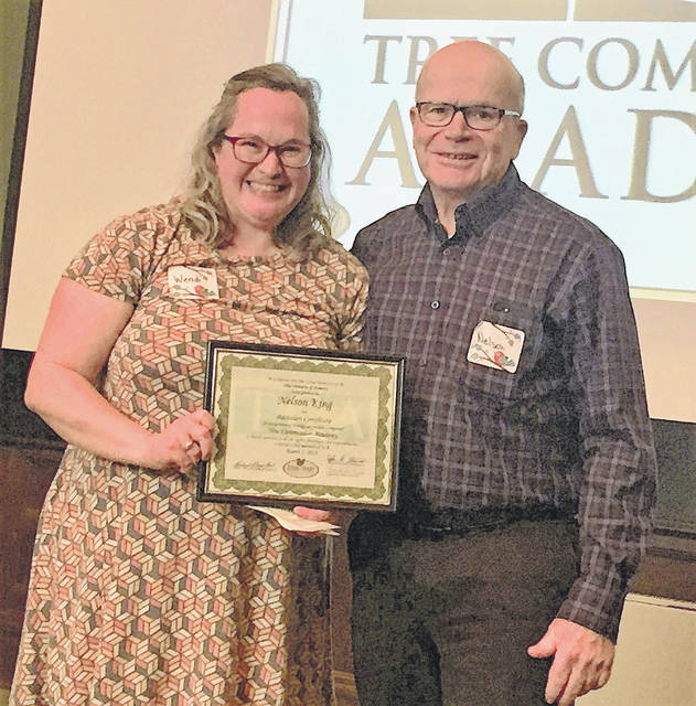 Submitted photo Nelson King, City of Xenia Tree Committee, receives his certificate from Wendi Van Buren, ODNR Urban Forester, during the Tree Academy Graduation Ceremony.