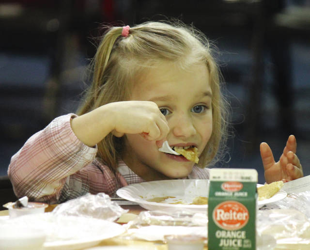 Anna Bolton | Greene County News Sophia Pace enjoys pancakes at Xenia Rotary Club's Annual Pancake Day April 4 at the fairgrounds. Club members served pancakes, sausage, orange juice, milk and coffee. Proceeds from the event support Xenia Rotary's Kevin Sonnycalb Memorial Fireworks Festival in July.