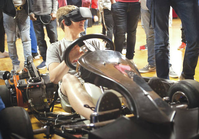 Submitted photo A participant explores virtual reality capabilities in gaming software during the sixth annual Full-Throttle STEM at Eldora Day in Rossburg. Students from seven local high schools showcased their STEM-related projects, including their modeling and simulation-based work, and then competed in a remote-controlled (RC) car race at Eldora Speedway.