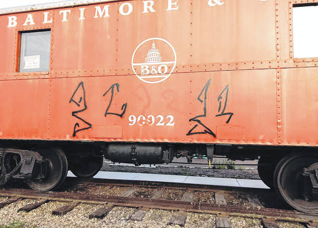 Submitted photo Graffiti painted on the caboose at Xenia Station will cost thousands to remove.