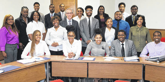 Submitted photo Louis Beck, cairman of Union Savings Bank, with members of the Summer Banking Institute 2018.