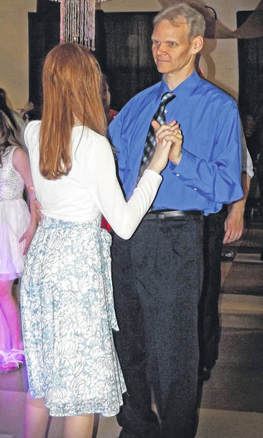 Submitted photos Greeneview Middle School recently held a father/daughter dance. Pictured Robert and Lia Betz enjoy the music.