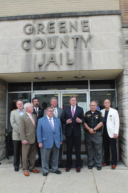 Anna Bolton | Greene County News Greene County Treasurer Dick Gould, Commissioner Alan Anderson, County Administrator Brandon Huddleson, Commissioner Bob Glaser, Commissioner Tom Koogler, Congressman Mike Turner, Sheriff Gene Fischer and Jail Administrator Maj. Kirk Keller discuss legislation efforts which would give inmates back their Medicaid benefits for addiction treatment 30 days prior to release.