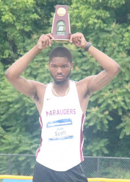 Central State University hurdler Juan Scott holds up his sixth-place trophy, May 26, at the NCAA Division II Track and Field Outdoor Championships in Charlotte, N.C.