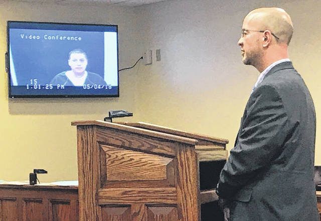 Anna Bolton | Greene County News Attorney Griff Nowicki speaks to defendant David Simpson, in jail, during a video arraignment May 4 in Greene County Common Pleas Court.