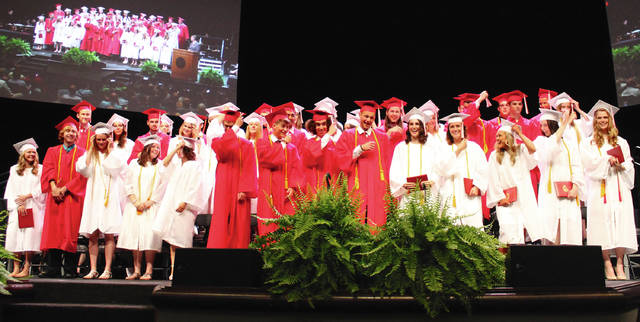 Anna Bolton | Greene County News Seniors from the Cedarville High School Class of 2018 move their tassels May 24 during graduation at Cedarville University.